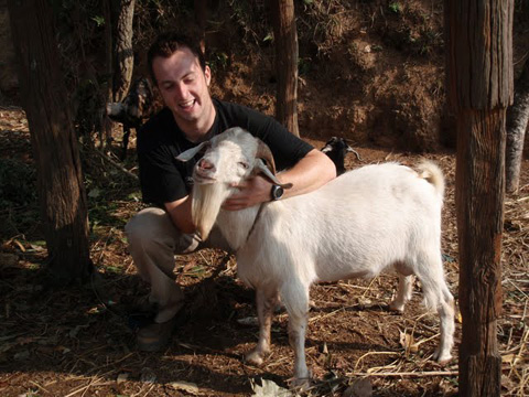 (Ciaran with Billy, a Boer cross buck goat)